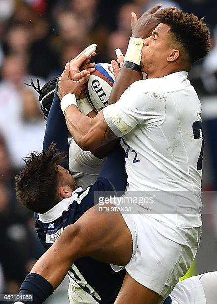 Scotland's scrumhalf Ali Price vies with England's Anthony Watson during the Six Nations international rugby union match between England and Scotland...