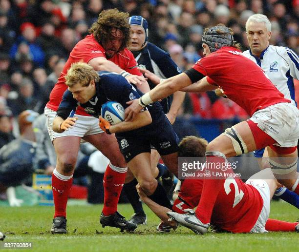 Scotland's Sean Lamont is caught by Wales' Adam Jones and Rhys Thomas during the RBS 6 Nations match at Murrayfield Stadium Edinburgh
