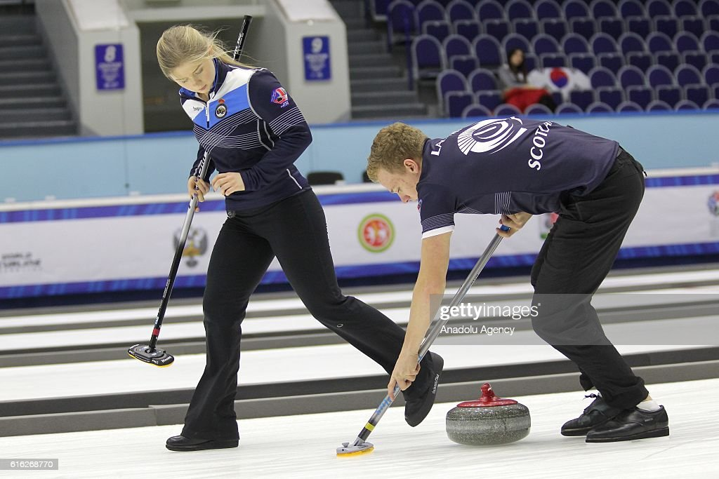 Scotland's second Bobby Lammie (R) end lead Sophie Jackson (L) in action during semi-finals the game between Sweden and Scotland within the World Mixed Curling Championship 2016 at the Sport Palace in Kazan, Russia on October 22, 2016.