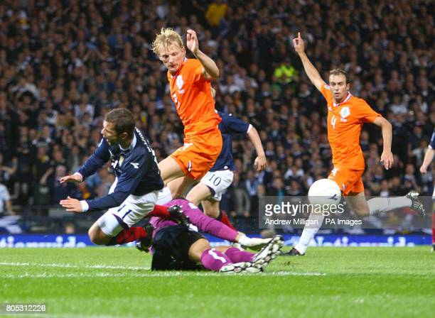 Scotland's Shaun Maloney collides with Holland's goalkeeper Michel Vorm as he tries a shot on goal