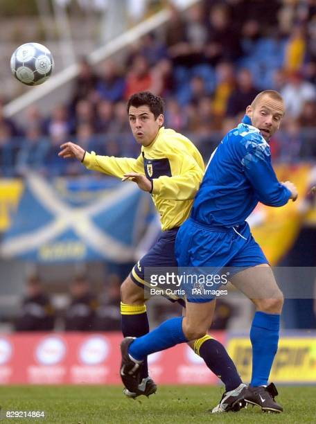 Scotland's Steven Thompson heads the ball past Iceland's Larus Orri Sigurdsson during their European Championship Qualifying Group 5 match at the...