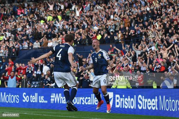 Scotland's striker Leigh Griffiths celebrates with Scotland's defender Christophe Berra after scoring their second goal during the group F World Cup...