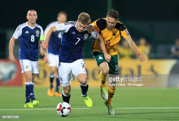 Scotland's Stuart Armstrong and Lithuania's Arturas Zulpa battle for the ball during the 2018 FIFA World Cup Qualifying Group F match at the LFF...