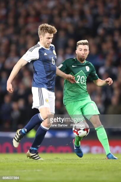 Scotland's Stuart Armstrong and Slovenia's Kevin Kampl during the World Cup Qualifying match at Hampden Park Glasgow