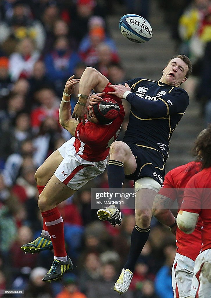 Scotland's Stuart Hogg (R) challenges Wale's Leigh Halfpenny (L) during the Six Nations international rugby union match between Scotland and Wales at Murrayfield, in Edinburgh on March 9, 2013.