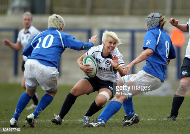 Scotland's Tanya Griffiths and Italy's Michela Tondinelli and Silvia Gaudino during the Women's 6 Nations match at Meggetland Edinburgh