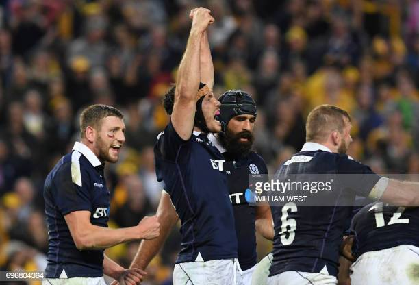 Scotland's Tim Swinson celebrates beating Australia in their rugby union Test match in Sydney on June 17 2017 / AFP PHOTO / William WEST / IMAGE...