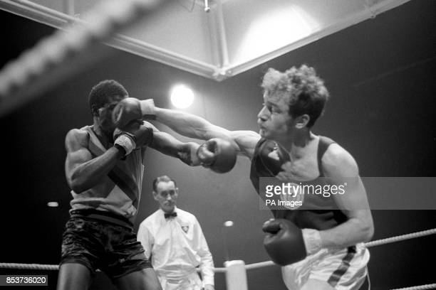 Scotland's Tom Imrie lands a blow on the face of Zambia's Julius Luipa during the light middleweight boxing final at the Commonwealth Games in...
