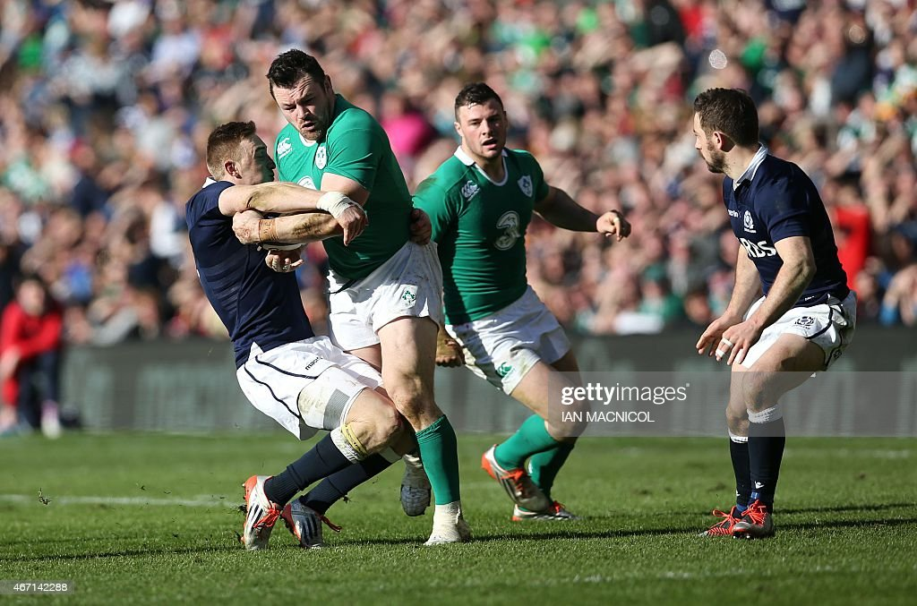 Scotland's wing Dougie Fife (L) tackles Ireland's prop <a gi-track='captionPersonalityLinkClicked' href=/galleries/search?phrase=Cian+Healy&family=editorial&specificpeople=4166531 ng-click='$event.stopPropagation()'>Cian Healy</a> during the Six Nations international rugby union match between Scotland and Ireland at Murrayfield in Edinburgh, Scotland on March 21, 2015. AFP PHOTO / IAN MACNICOL