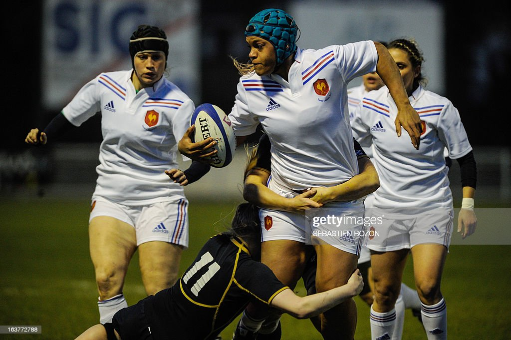 Scotland's wing Megan Gaffney (2ndL) tackles France's Safi N'Diaye during the Six Nations women's international rugby union match between France and Scotland at the Bourillot Stadium in Longvic, eastern France, on March 15, 2013. AFP PHOTO / SEBASTIEN BOZON