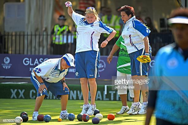 Scotland's women bowlers react as they compete in the womens fours against the Cook Islands at Kelvingrove Lawn Bowls Centre during day one of the...