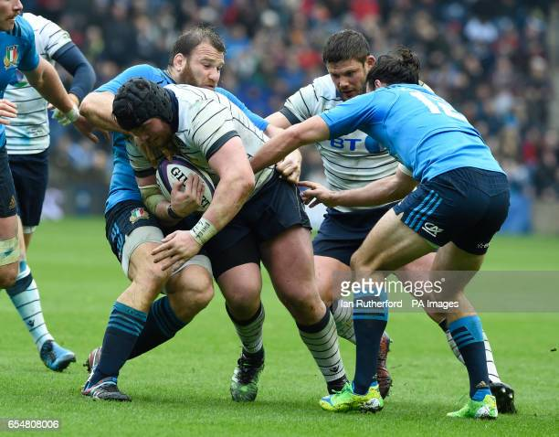 Scotland's Zander Fagerson is held by Italy's Lorenzo Cittadini and Luke McLean with Ross Ford of Scotland up in support during the RBS Six Nations...