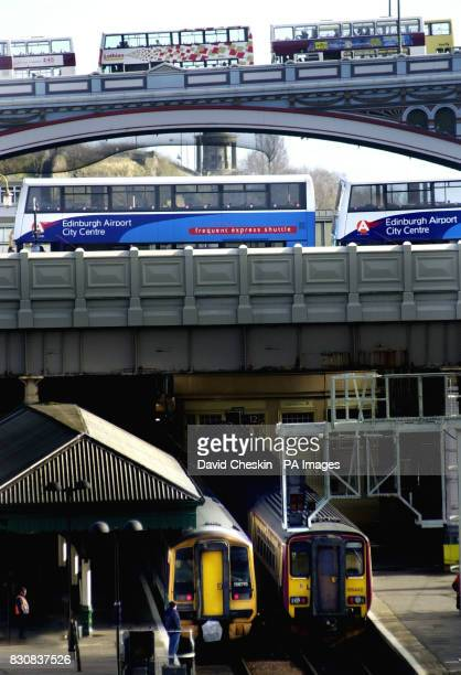 ScotRail trains stand empty at Edinburgh's Waverley Station while buses line up to cross the North Bridge in the city centre as commuters faced the...