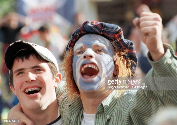 Scots fans celebrate Scotland's equaliser against Norway as they watch the World Cup Match live on a giant TV screen at Bellahouston Park Glasgow...