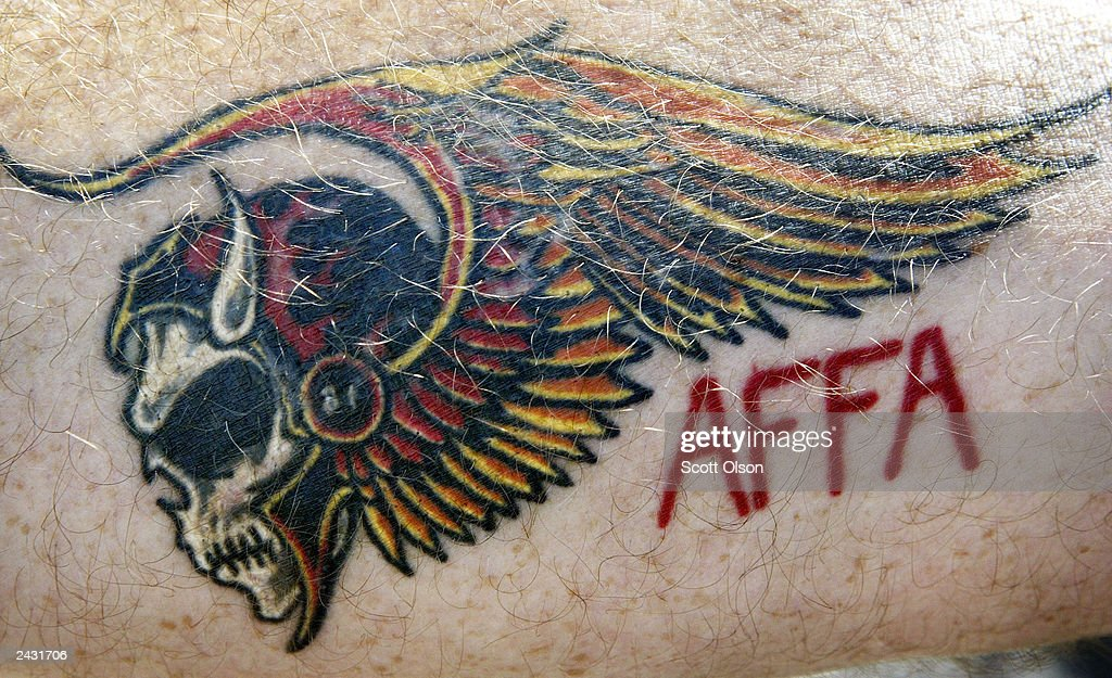 Scott, a member of the Illinois Nomads charter of the Hells Angels motorcycle club, shows off a recent tattoo on his forearm during a Hells Angels rally August 23, 2003 in Quincy, Illinois. The flaming skull is a Hells Angels insignia. AFFA stands for 'Angels Forever, Forever Angels.'