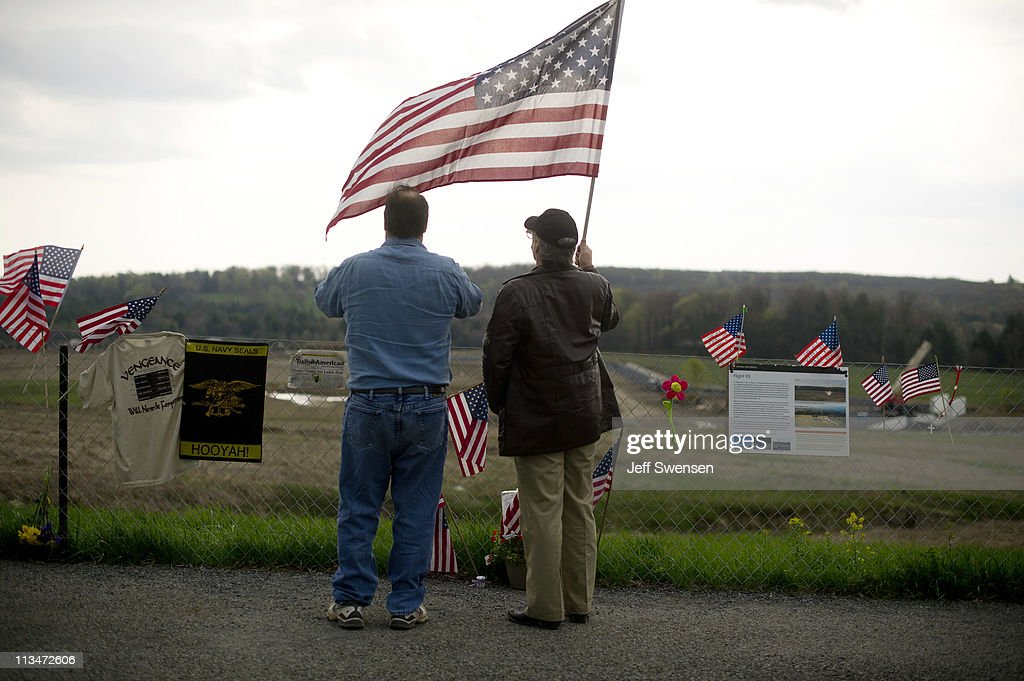 Scott and Walter Neilly, brothers, from Bradford, Pa look over the crash site of Flight 93 following the announcement that Osama Bin Laden had been killed in Pakistan May 2, 2011 in Shanksville, Pennsylvania. Nearly 10 years after September 11, 2001 construction is underway to erect a formal memorial at the crash site. Last night U.S. President Barack Obama announced that the United States had killed the most-wanted terrorist Osama Bin Laden in an operation led by U.S. Special Forces in a compound in Abbottabad, Pakistan.