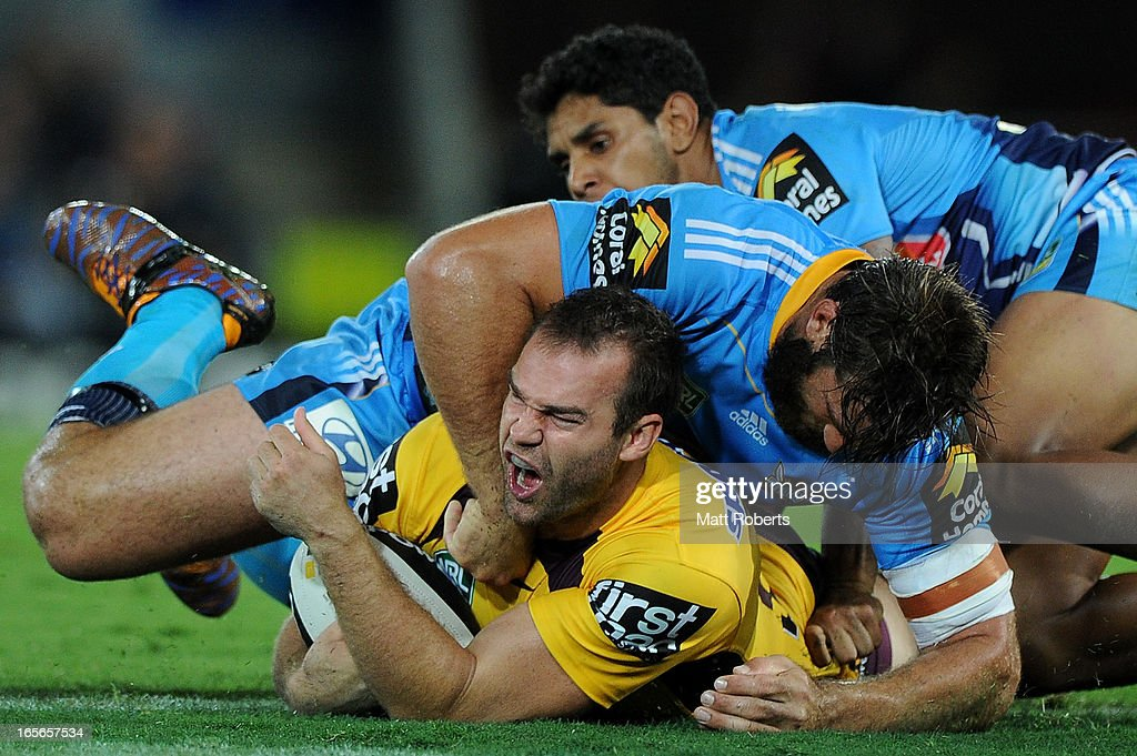 Scott Anderson of the Broncos reacts in the tackle during the round five NRL match between the Gold Coast Titans and the Brisbane Broncos at Skilled Park on April 5, 2013 on the Gold Coast, Australia.