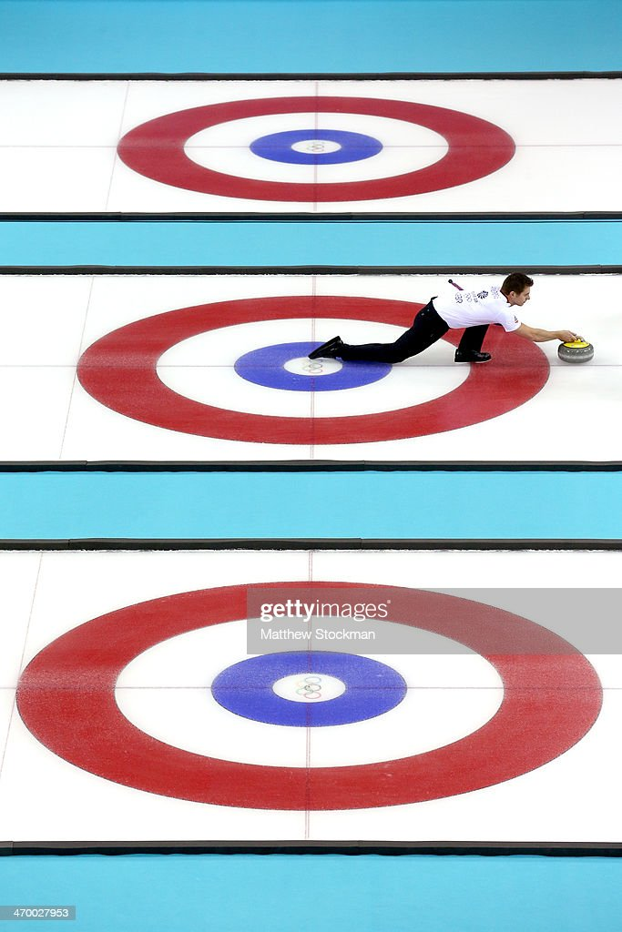 Scott Andrews of Great Britain throws the rock while playing Norway during the Curling at Ice Cube Curling Center on day 11 of the 2014 Sochi Winter Olympics on February 18, 2014 in Sochi, Russia.