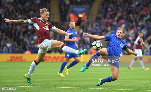Scott Arfield of Burnley and Daniel Drinkwater of Leicester CiDaniel Drinkwater of Leicester City both stretch to reach to the ball during the...