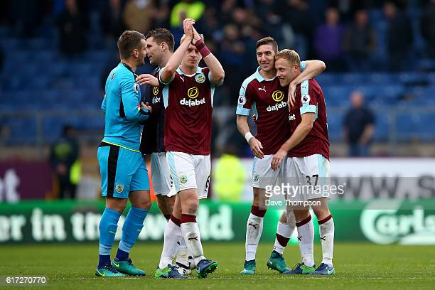 Scott Arfield of Burnley celebrates after the final whistle with his Burnley team mates during the Premier League match between Burnley and Everton...