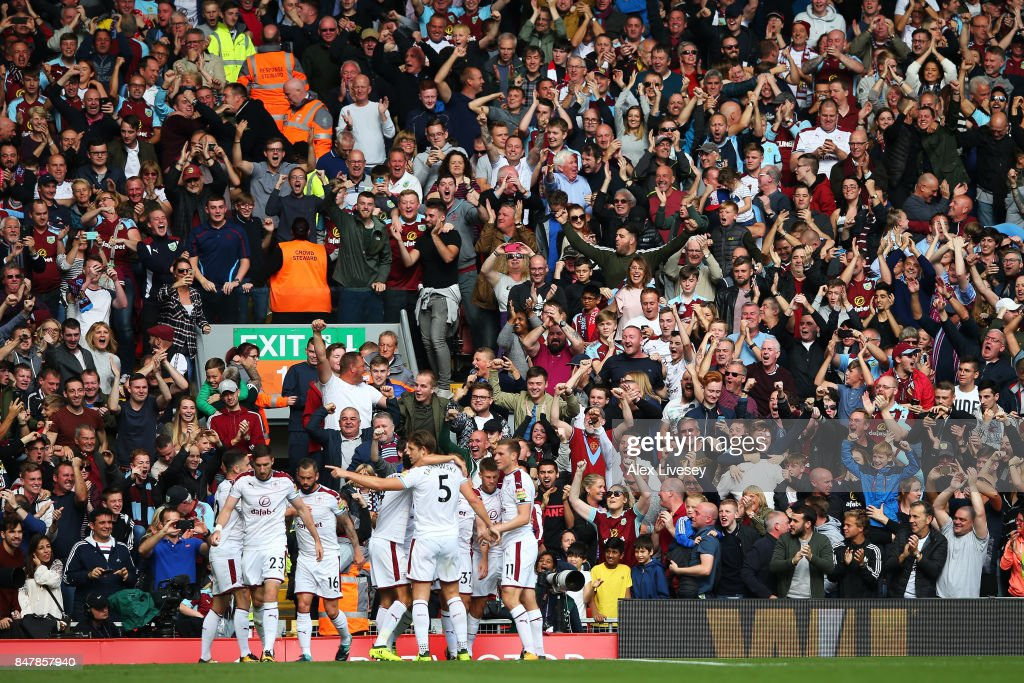 Scott Arfield of Burnley celebrates scoring his sides first goal with his Burnley team mates and the Burnley fans during the Premier League match between Liverpool and Burnley at Anfield on September 16, 2017 in Liverpool, England.