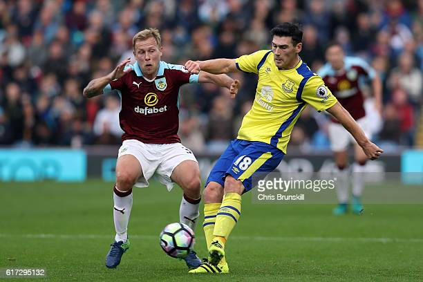 Scott Arfield of Burnley in action with Gareth Barry of Everton during the Barclays Premier League match between Burnley and Everton on October 22...