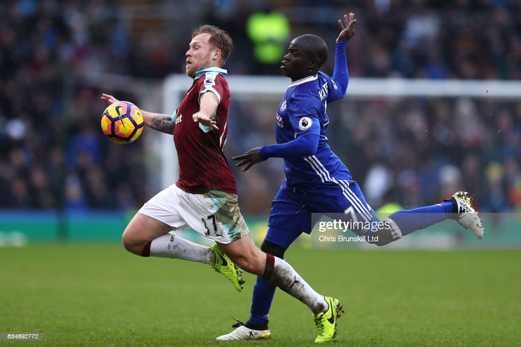 Scott Arfield of Burnley in action with N'Golo Kante of Chelsea during the Premier League match between Burnley and Chelsea at Turf Moor on February 12, 2017 in Burnley, England.
