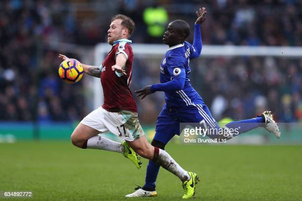 Scott Arfield of Burnley in action with N'Golo Kante of Chelsea during the Premier League match between Burnley and Chelsea at Turf Moor on February...