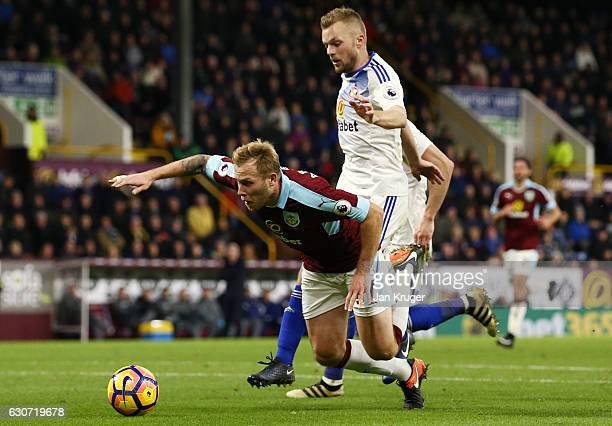 Scott Arfield of Burnley is challenged by Sebastian Larsson of Sunderland resulting in a penalty kick during the Premier League match between Burnley...