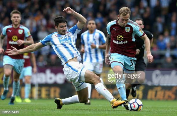 Scott Arfield of Burnley is tackled by Christopher Schindler of Huddersfield Town during the Premier League match between Burnley and Huddersfield...