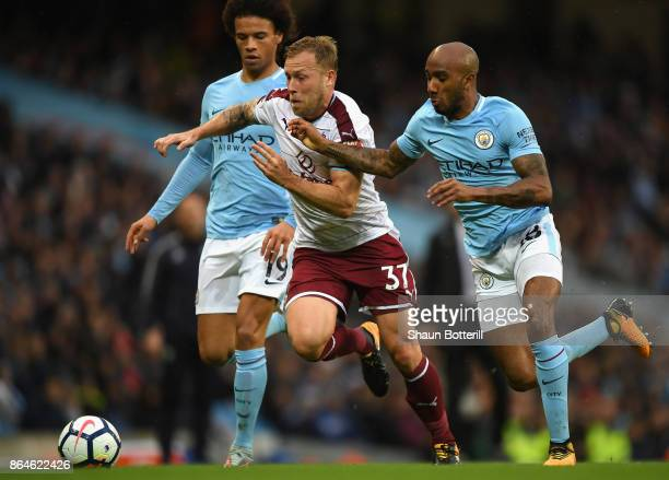 Scott Arfield of Burnley takes on Leroy Sane and Fabian Delph of Manchester City during the Premier League match between Manchester City and Burnley...