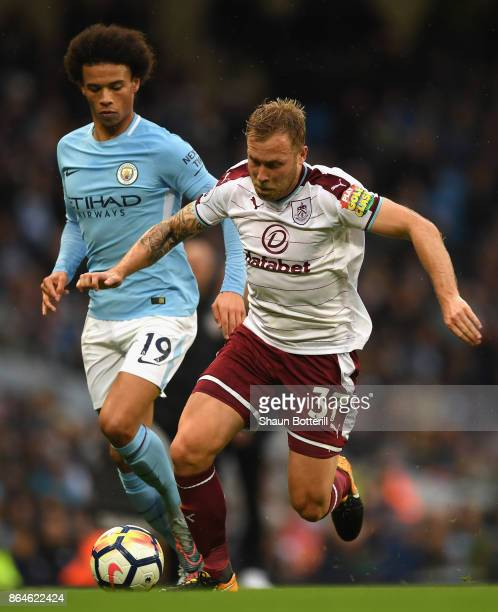 Scott Arfield of Burnley takes on Leroy Sane of Manchester City during the Premier League match between Manchester City and Burnley at Etihad Stadium...