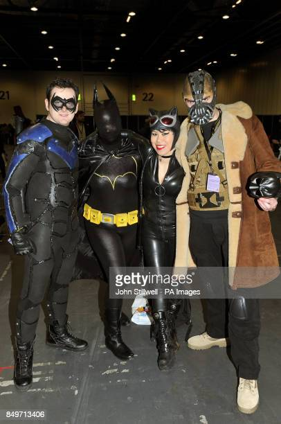 Scott as Knight Wing Pheobe as Batgirl Jojo as Cat Woman and Anthony as Bane all in costume for the annual London Super Comic Convention held at the...
