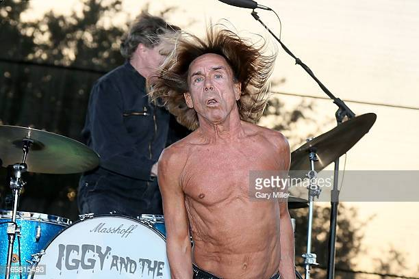 Scott Asheton and Iggy Pop of Iggy and the Stooges perform in concert during the Free Press Summer Festival at Eleanor Tinsley Park on June 1 2013 in...