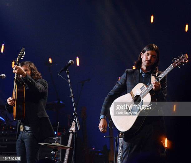Scott Avett and Seth Avett perform during CMT Crossroads The Avett Brothers And Randy Travis tape at The Factory Liberty Hall in Franklin Tennessee...
