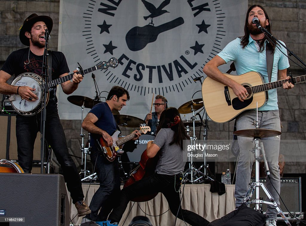 Scott Avett, Bob Crawford, Mike Marsh, Joe Kwon and Seth Avett of the Avett Brothers perform during the 2013 Newport Folk Festival at Fort Adams State Park on July 27, 2013 in Newport, Rhode Island.