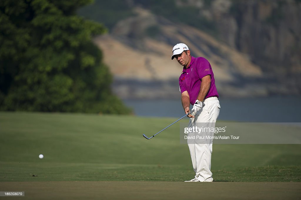 Scott Barr of Australia chips onto the 17th green during round two of the Venetian Macau Open on October 18, 2013 at the Macau Golf & Country Club in Macau. The Asian Tour tournament offers a record US$ 800,000 prize money which goes through October 20.
