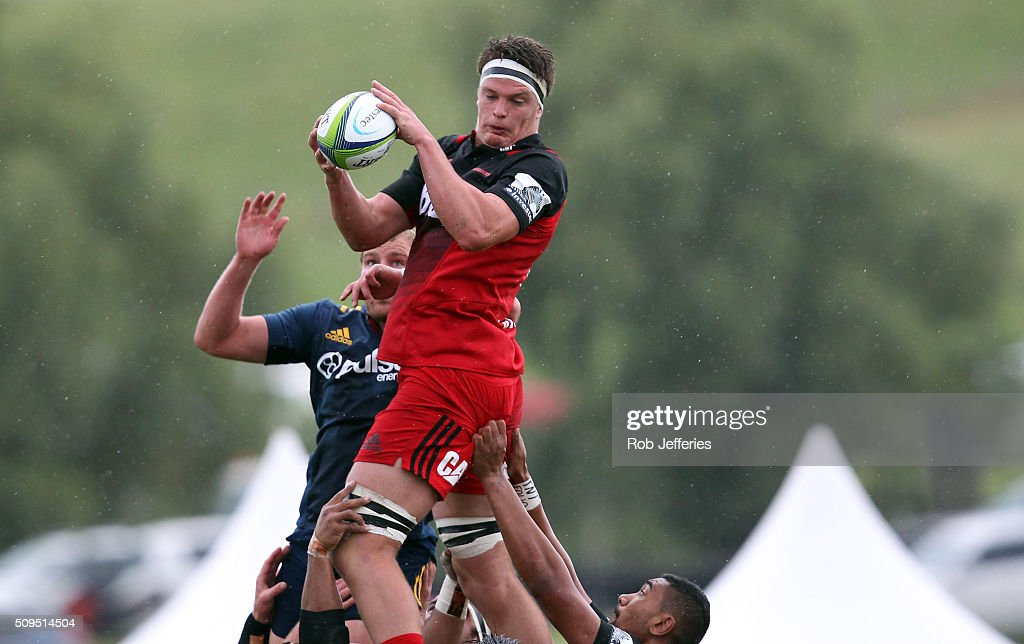 Scott Barrett of the Crusaders takes clean lineout ball during the Super Rugby trial match between the Highlanders and the Crusaders at Fred Booth Park on February 11, 2016 in Waimumu, New Zealand.