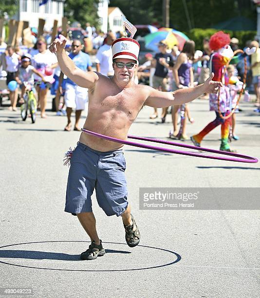 Scott Belanger of Ocean Park shows off his HulaHooping skills with the group 'Hoopsters' during the sixtieth annual Independence Day Community Parade...