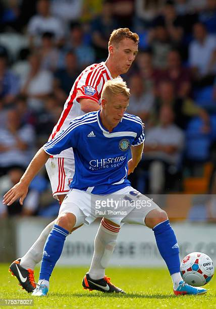 Scott Boden of Macclesfield in action with Jordan Keane of Stoke City during the Pre Season Friendly match between Macclesfield Town and Stoke City...