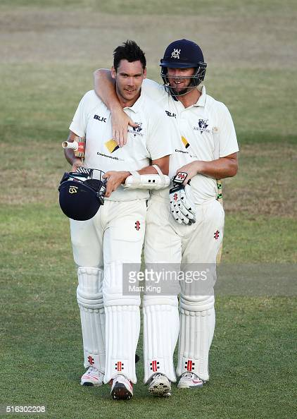 Scott Boland and Cameron White of the Bushrangers celebrate after holding on for a draw during day four of the Sheffield Shield match between...