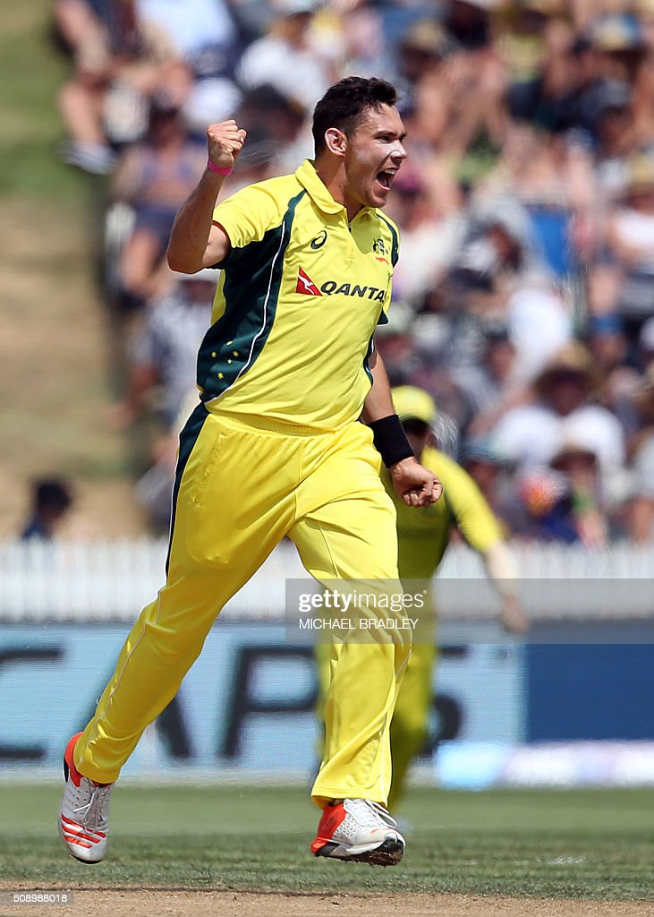 Scott Boland of Australia celebrates taking the wicket of New Zealand's Kane Williamson during the third one-day international cricket match between New Zealand and Australia at Seddon Park in Hamilton on February 8, 2016.   AFP PHOTO / MICHAEL BRADLEY / AFP / MICHAEL BRADLEY