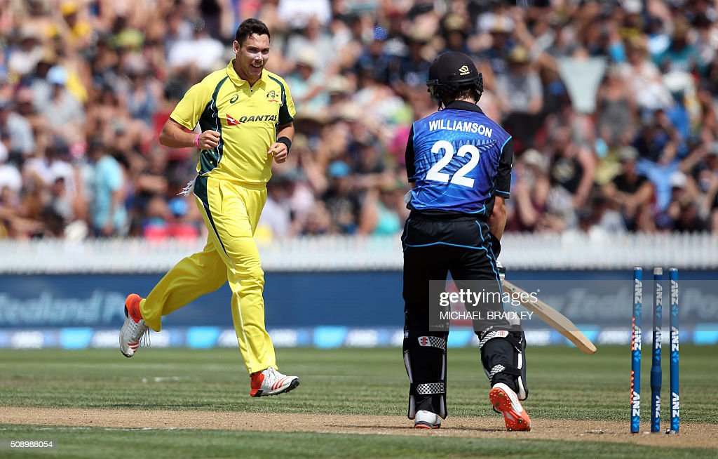 Scott Boland (L) of Australia celebrates taking the wicket of New Zealand's Kane Williamson (R) during the third one-day international cricket match between New Zealand and Australia at Seddon Park in Hamilton on February 8, 2016.   AFP PHOTO / MICHAEL BRADLEY / AFP / MICHAEL BRADLEY