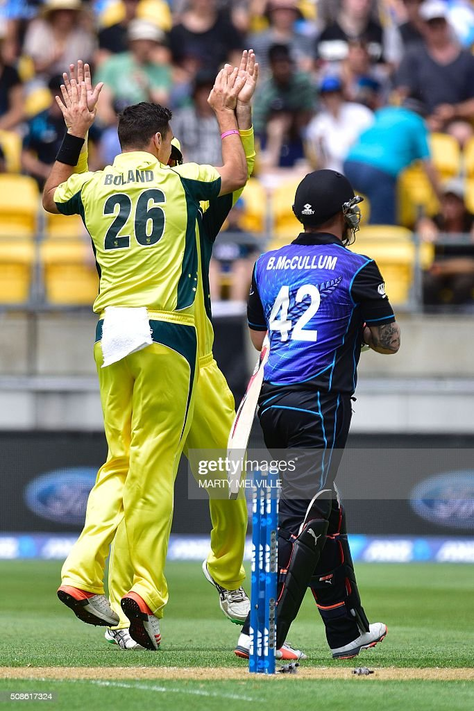 Scott Boland (L) of Australia celebrates with teammates after Brendon McCullum (R) of New Zealand was bowled during the 2nd one-day international cricket match between New Zealand and Australia at Westpac Stadium in Wellington on February 6, 2016. AFP PHOTO / MARTY MELVILLE / AFP / Marty Melville
