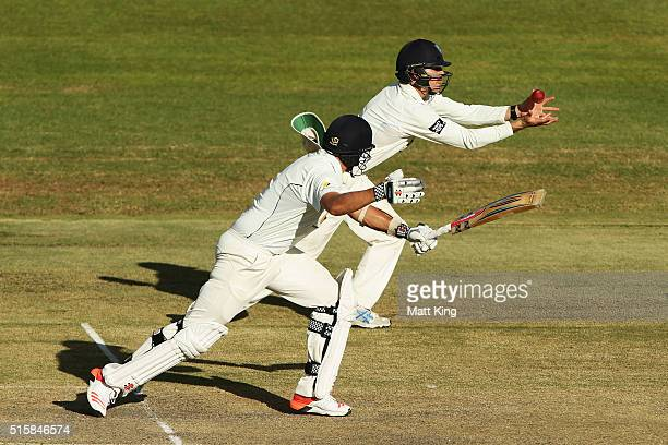Scott Boland of the Bushrangers is caught by Daniel Hughes of the Blues off the bowling of Nathan Lyon during day two of the Sheffield Shield match...