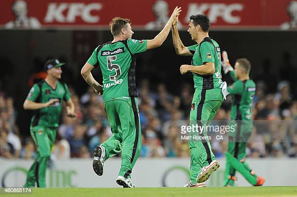 Scott Boland of the Stars celebrates a wicket with James Faulkner during the Big Bash League match between the Brisbane Heat and the Melbourne Stars...
