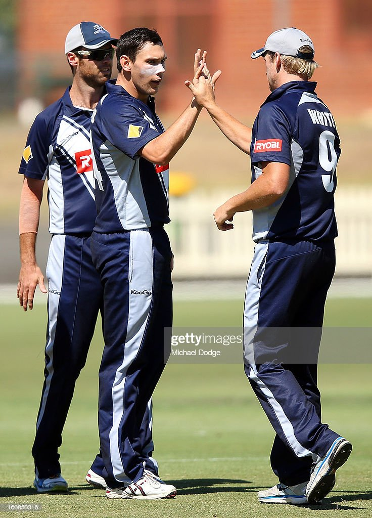 Scott Boland of Victoria celebrates a wicket with Cameron White (R) during the International tour match between the Victorian 2nd XI and the England Lions at Junction Oval on February 7, 2013 in Melbourne, Australia.