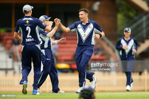 Scott Boland of Victoria celebrates tacking the wicket of Daniel Hughes of NSW during the JLT One Day Cup match between New South Wales and Victoria...