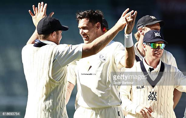 Scott Boland of Victoria celebrates with his teammates after dismissing George Bailey of Tasmania during day four of the Sheffield Shield match...