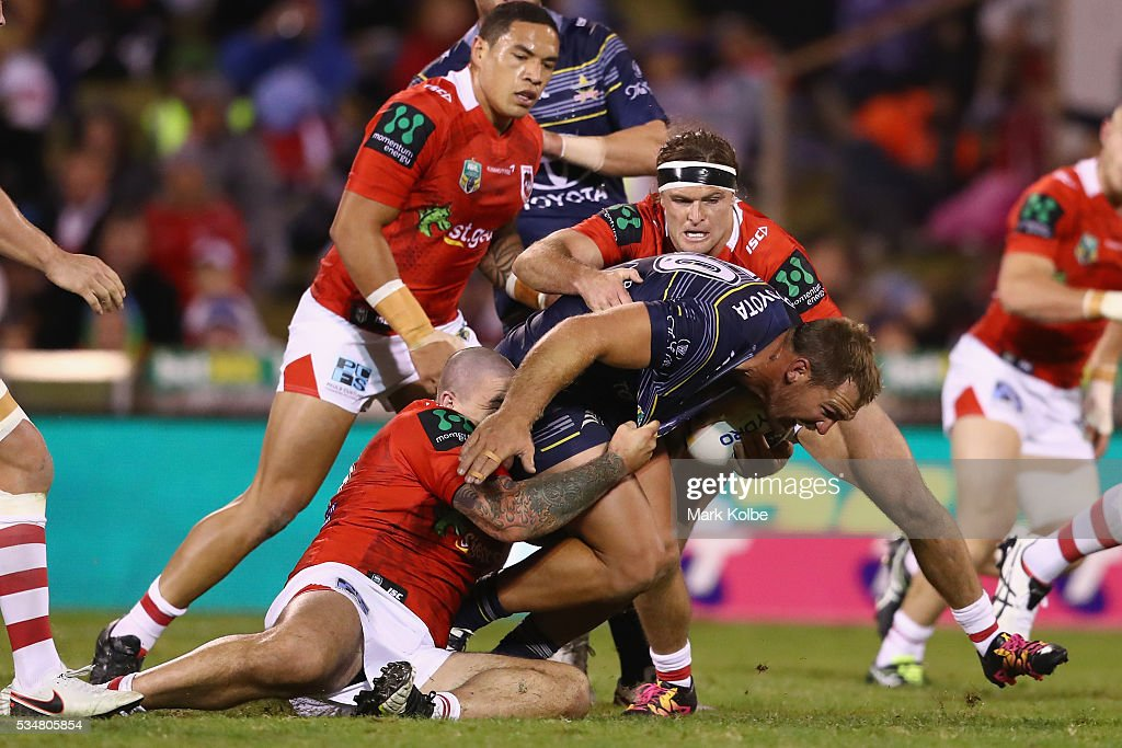 Scott Bolton of the Cowboys is tackled during the round 12 NRL match between the St George Illawarra Dragons and the North Queensland Cowboys at WIN Jubilee Stadium on May 28, 2016 in Wollongong, Australia.